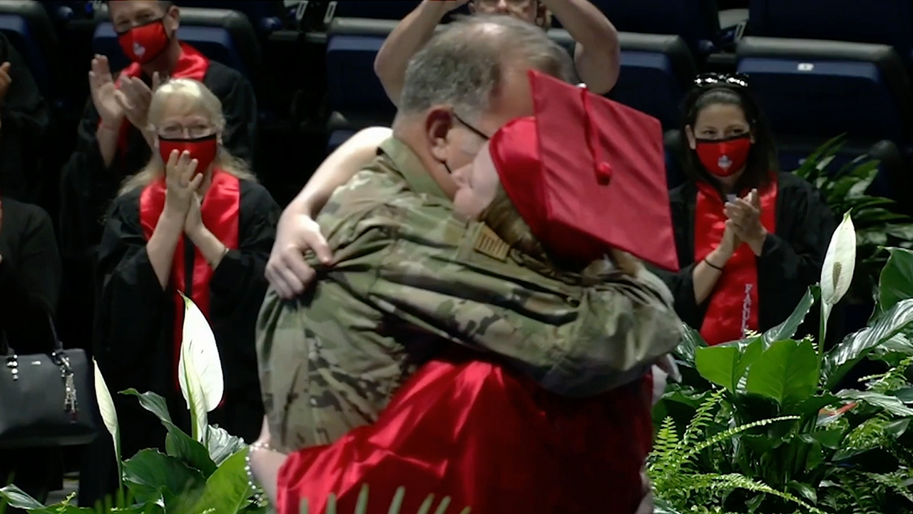Military father surprises daughter at high school graduation