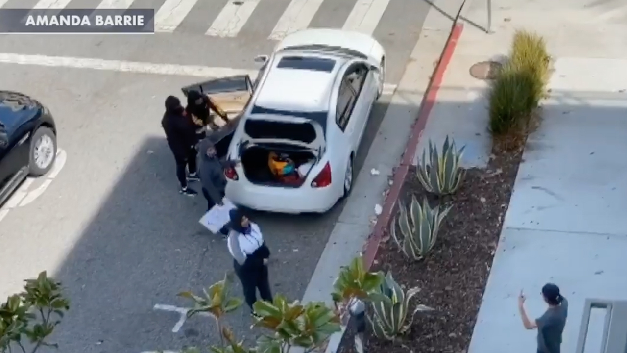 Santa Monica restaurant manager caught on video allegedly buying stolen television from looters