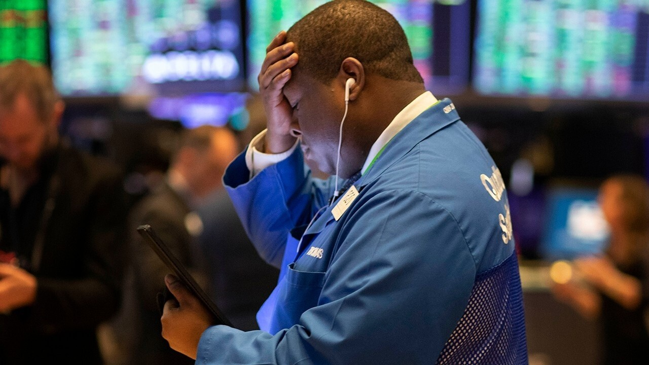 Trading halts for third time as coronavirus fears trigger market selloff