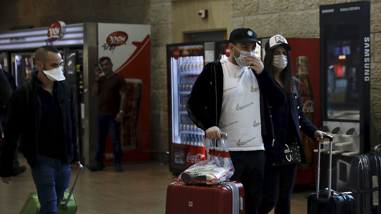 Israel imposes new travel restrictions as coronavirus spreads