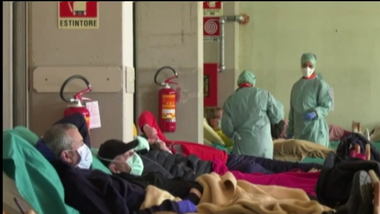 Italy's health care system remains inundated with COVID-19 cases
