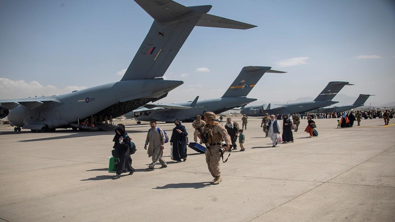 Afghanistan evacuation intensifies as Taliban sends message to Biden