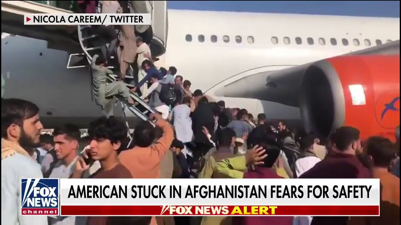American stranded in Afghanistan describes chaos at Kabul airport: 'It's crazy'