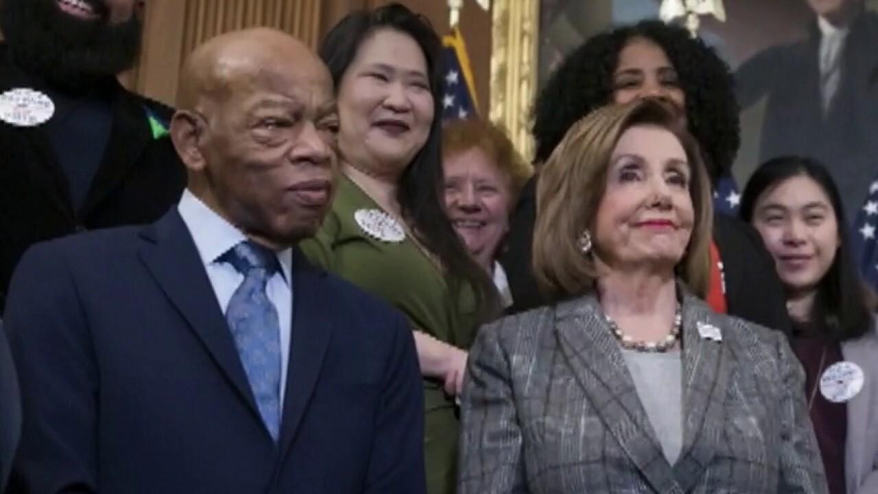 House Speaker Nancy Pelosi praises Rep. John Lewis as