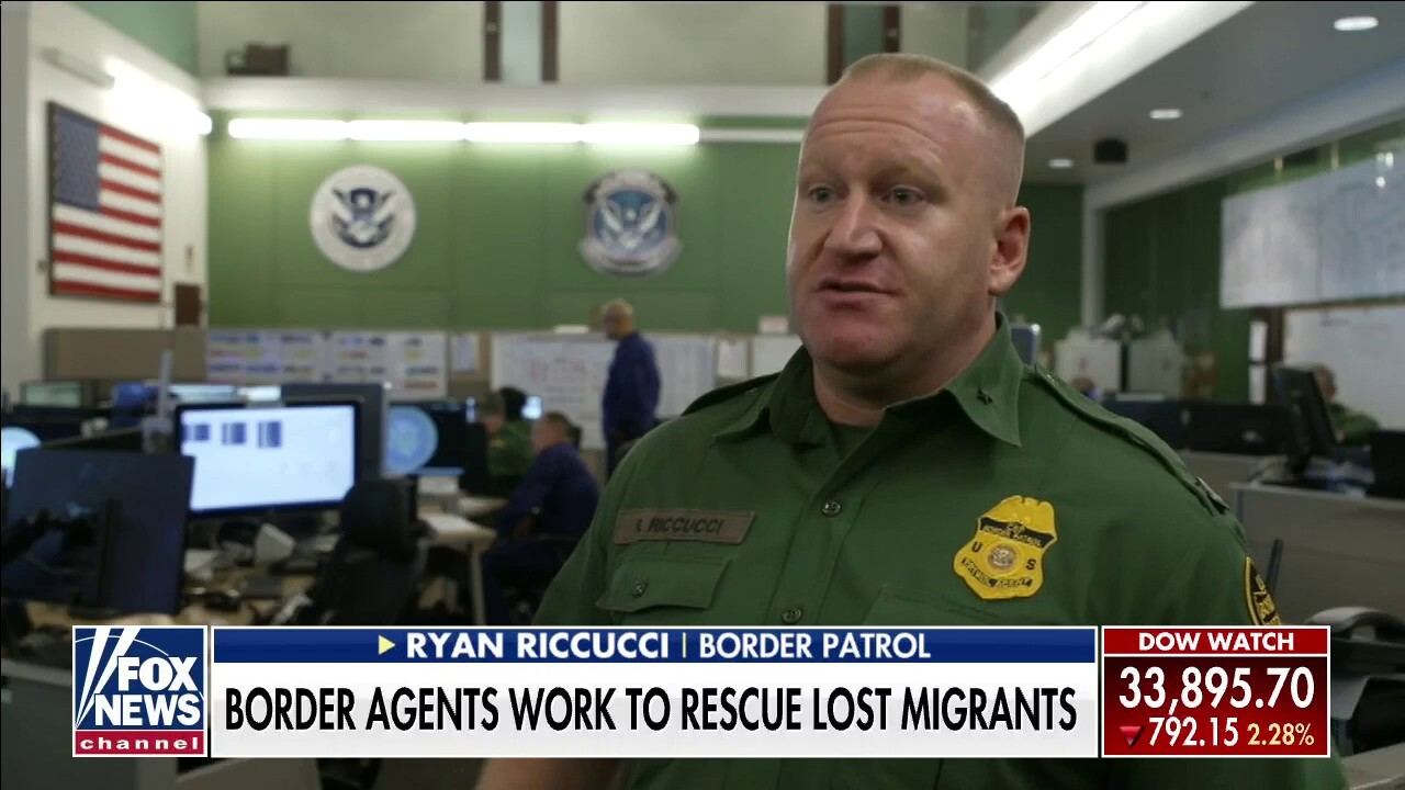 Border Patrol agents work to rescue distressed migrants crossing the desert