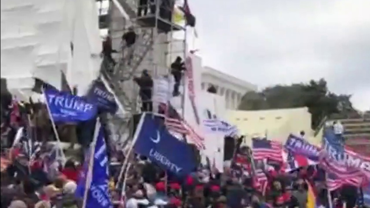 Pro-Trump protesters breach Capitol, disrupt Electoral College count