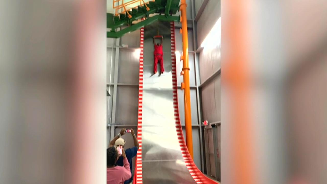 Man screams, refuses to go down 32-foot slide