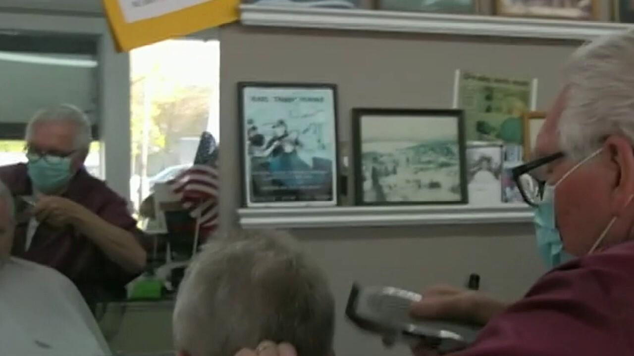 77-year-old barbershop owner defies coronavirus order, reopens business
