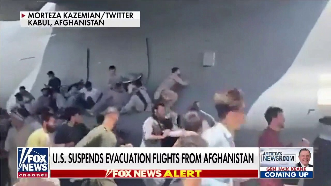 Afghans cling to departing planes, US suspends evacuation flights from Kabul airport