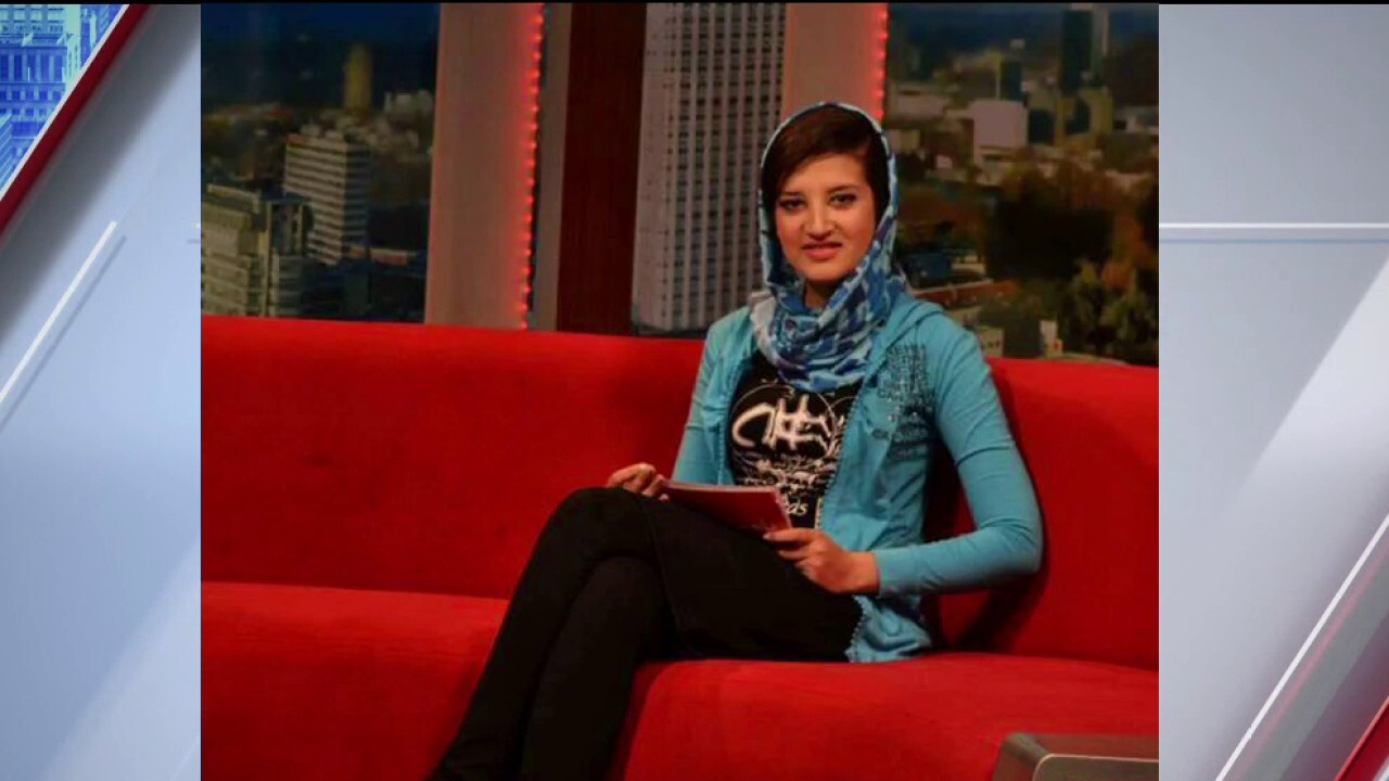 Afghan former TV producer lives in hope that her family is rescued from Taliban