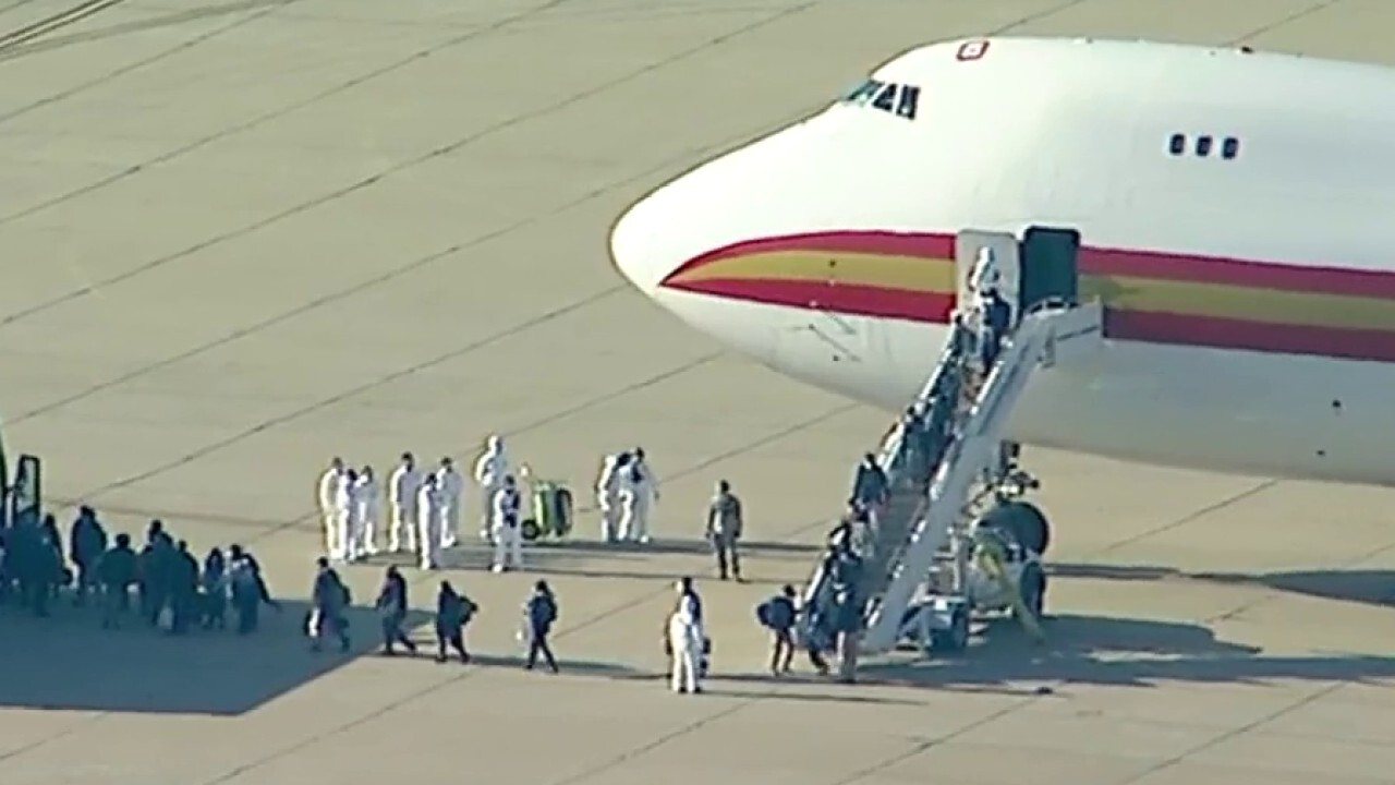 Evacuated Americans deplane from a chartered flight from Chinese epicenter of coronavirus outbreak