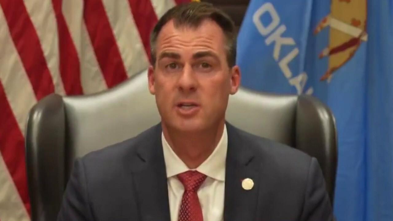 Oklahoma governor defends critical race theory ban