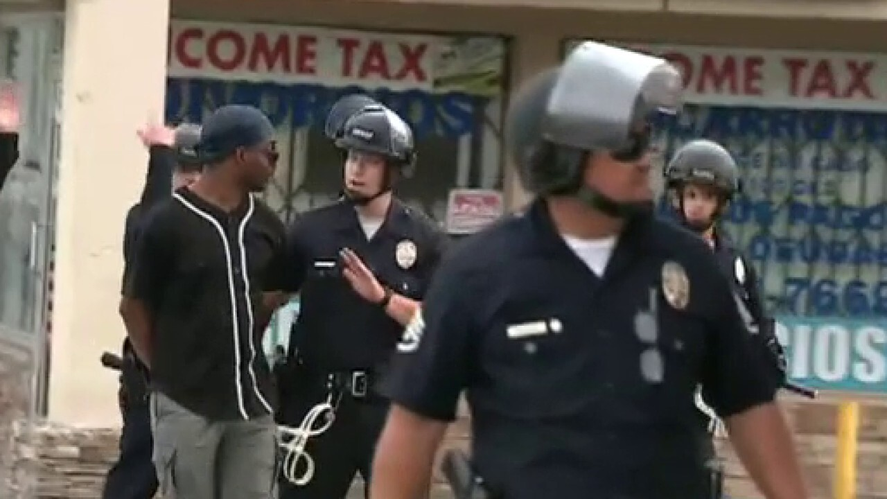 Neighbors protecting Los Angeles business from looters handcuffed on live TV