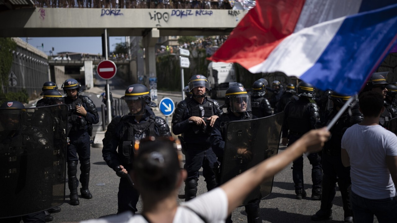 Protests erupt in France against COVID health passes