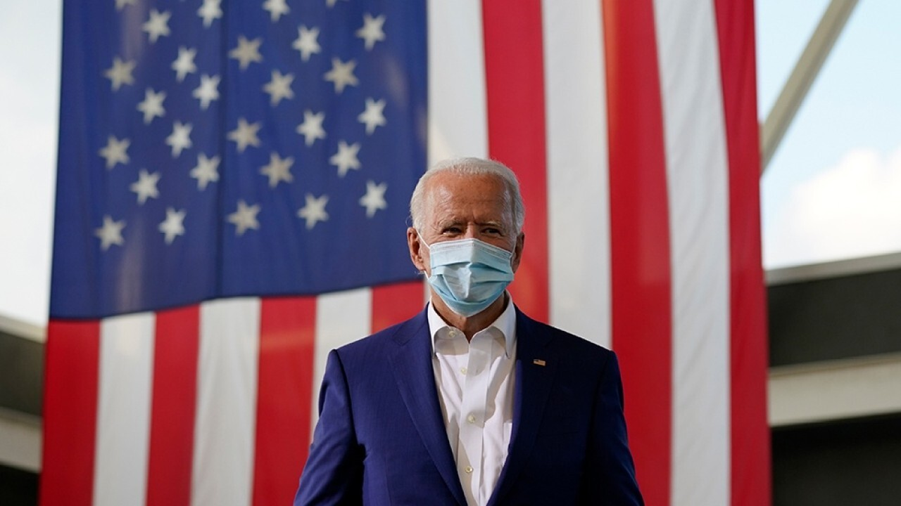 Biden campaign aide, flight crew member test positive for COVID-19