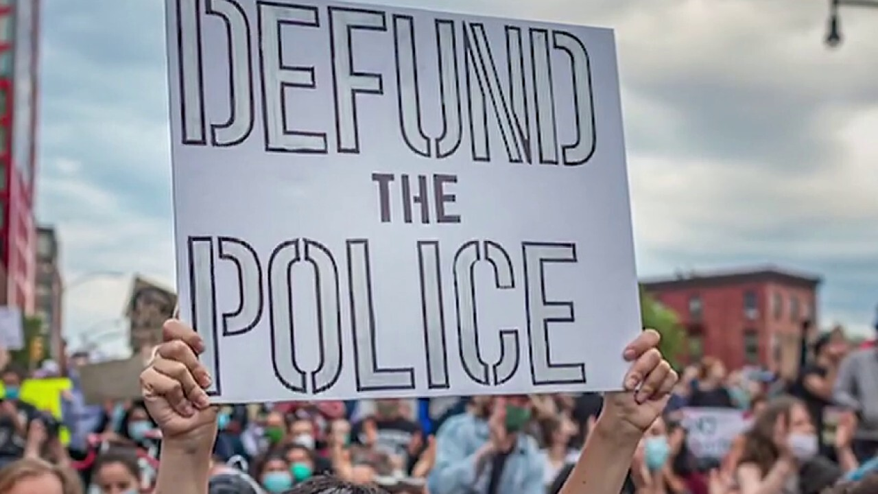 US cities rally to 're-fund the police'