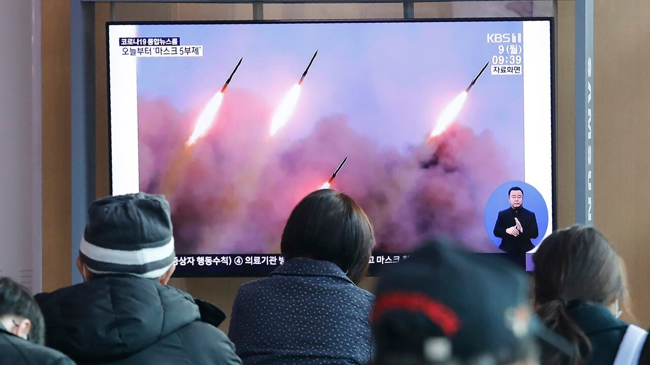 North Korea fires weapons after threatening 'momentous' action
