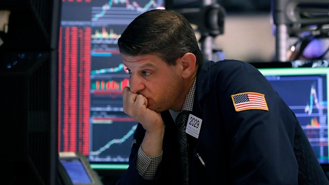 Wall Street halts trading for 2nd time this week amid spread of coronavirus worldwide