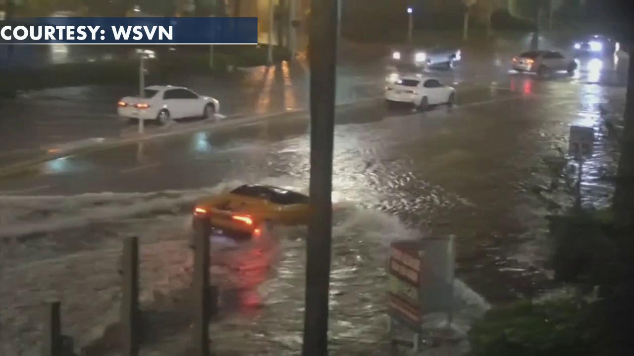 Lamborghini drives through floodwaters in Miami