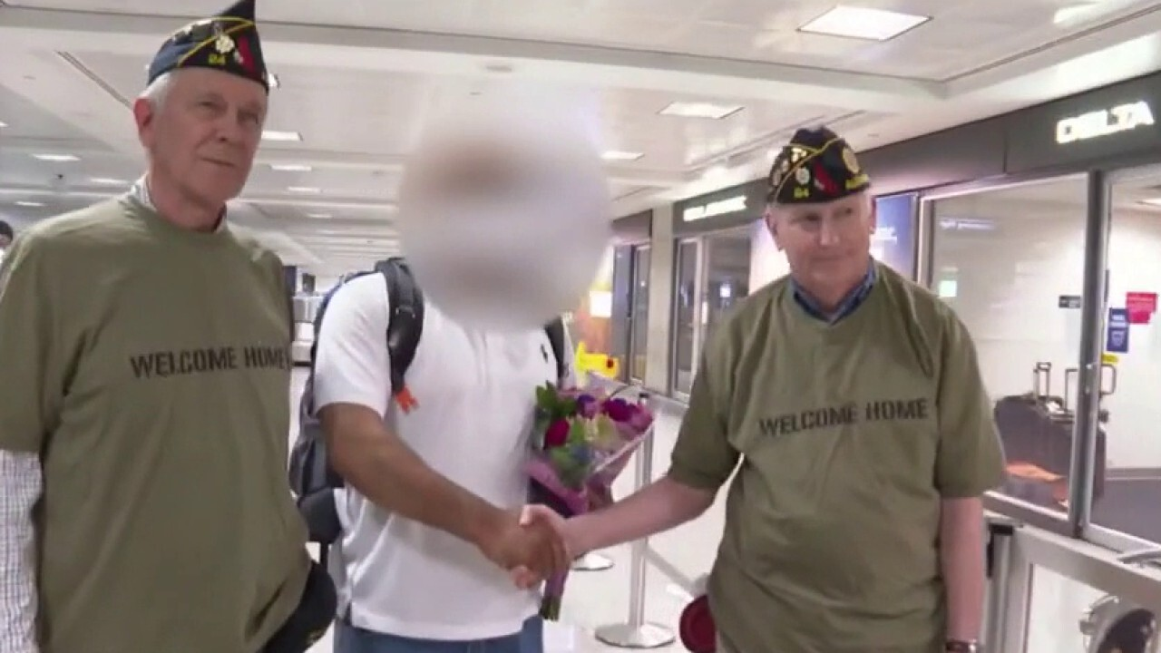 Afghanistan translator greeted by veterans after arriving in US with visa