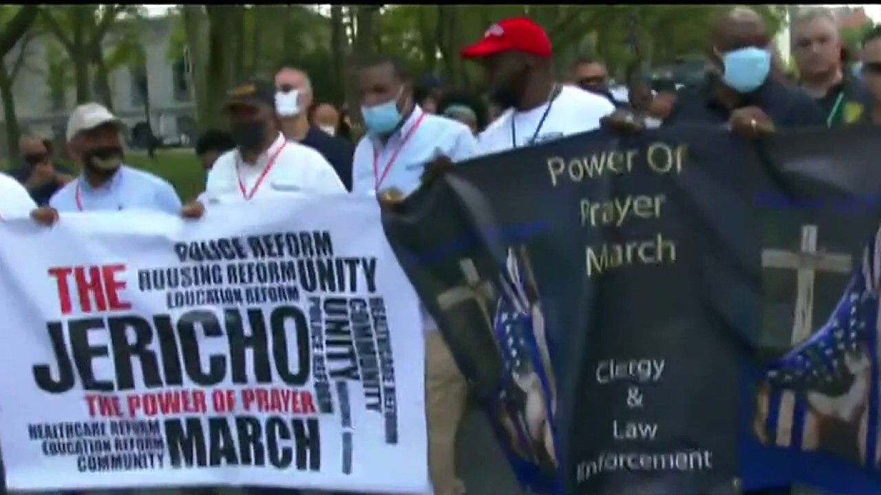 Protesters clash with police at pro-police march organized by clergy