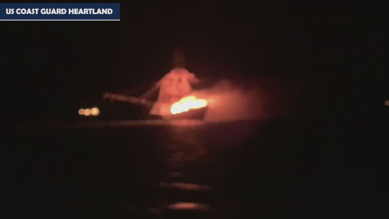Coast Guard rescues four from vessel fire