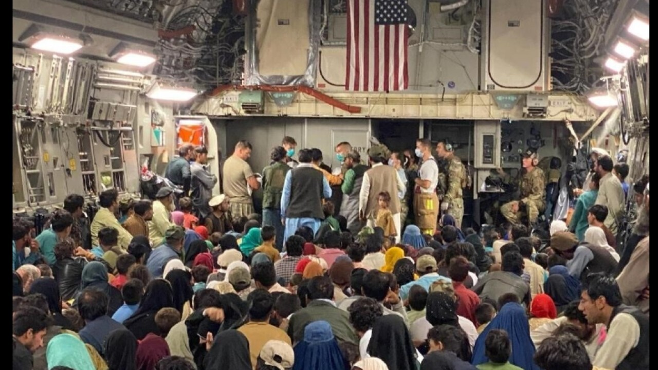 Air Force airlift crew on delivering Afghan woman's baby en route to Qatar