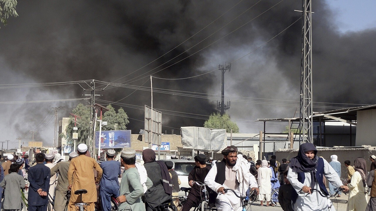 Afghans take cover near airport as gunfire rings out