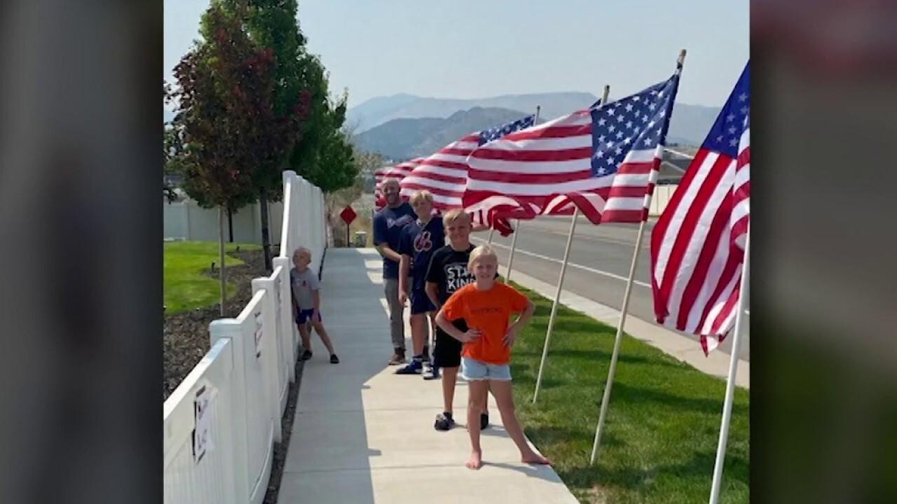 Utah children create neighborhood display honoring 13 fallen heroes