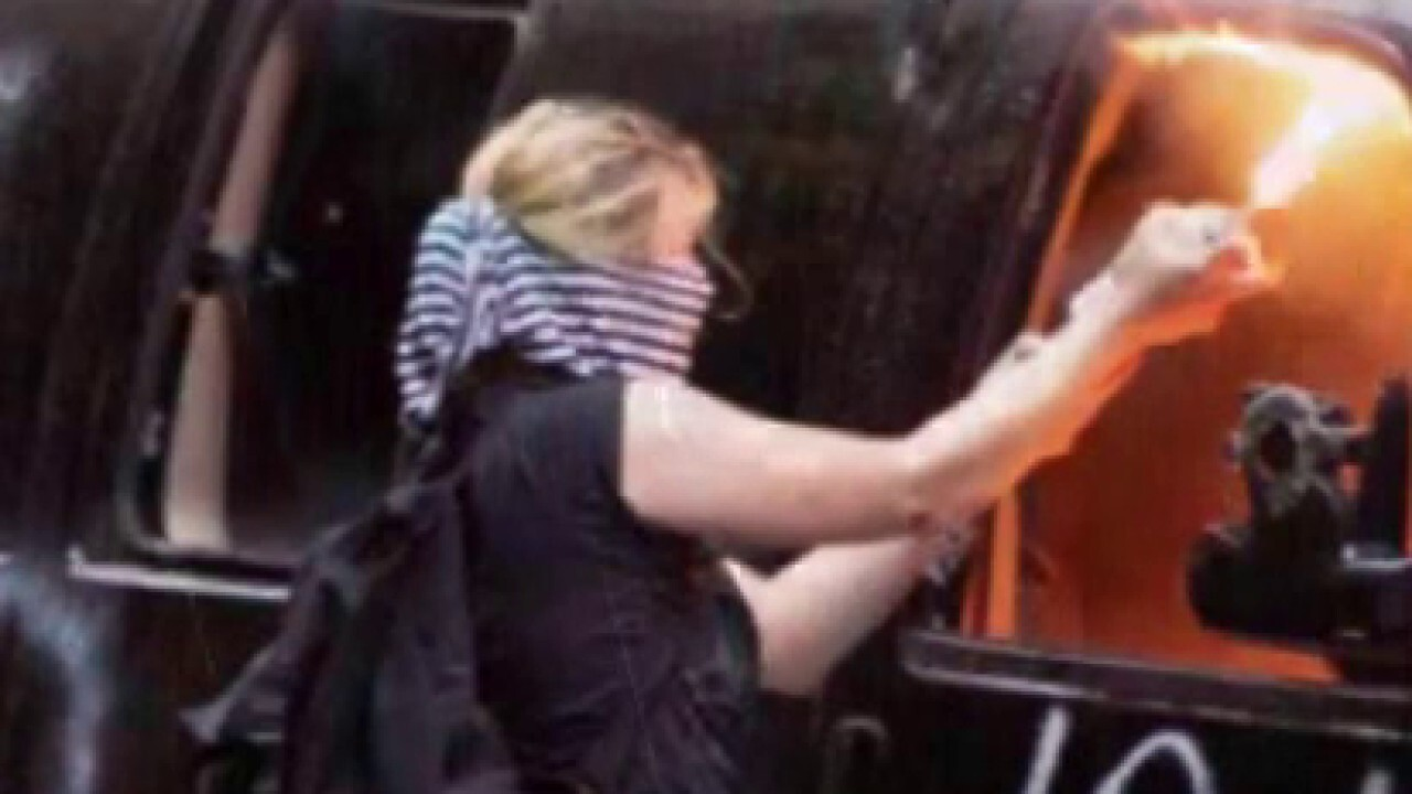Activist charged with torching police cars in Seattle
