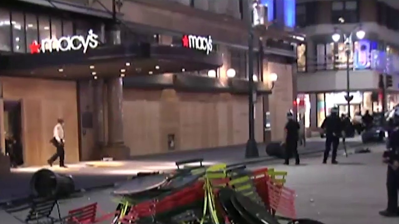 Iconic NYC stores boarded up after another night of looting and violence