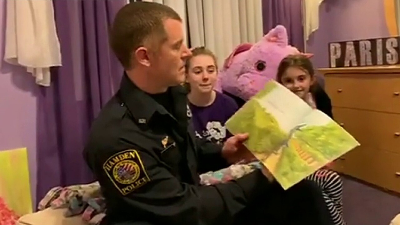 Police officers bring smiles to children amid coronavirus pandemic