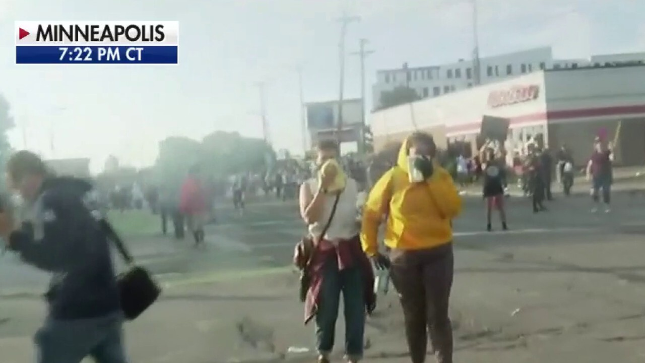 Protesters in tense standoff with police following riots in Minneapolis over man's death in police custody