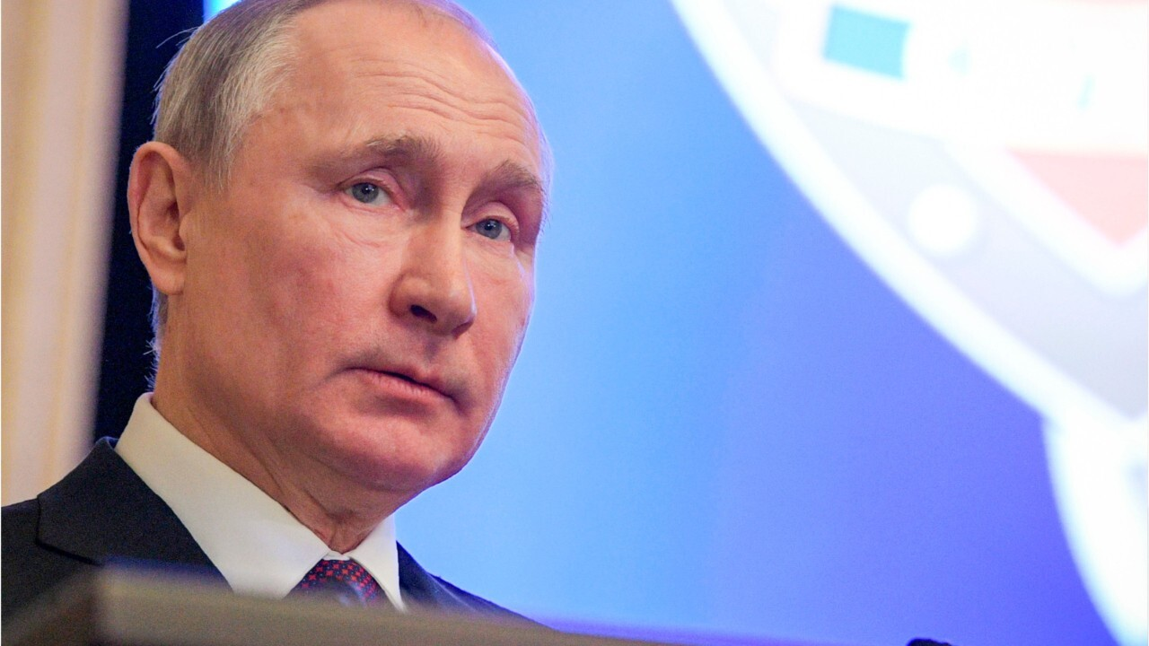 Who is Vladimir Putin, the Russian president and ex-KGB officer?