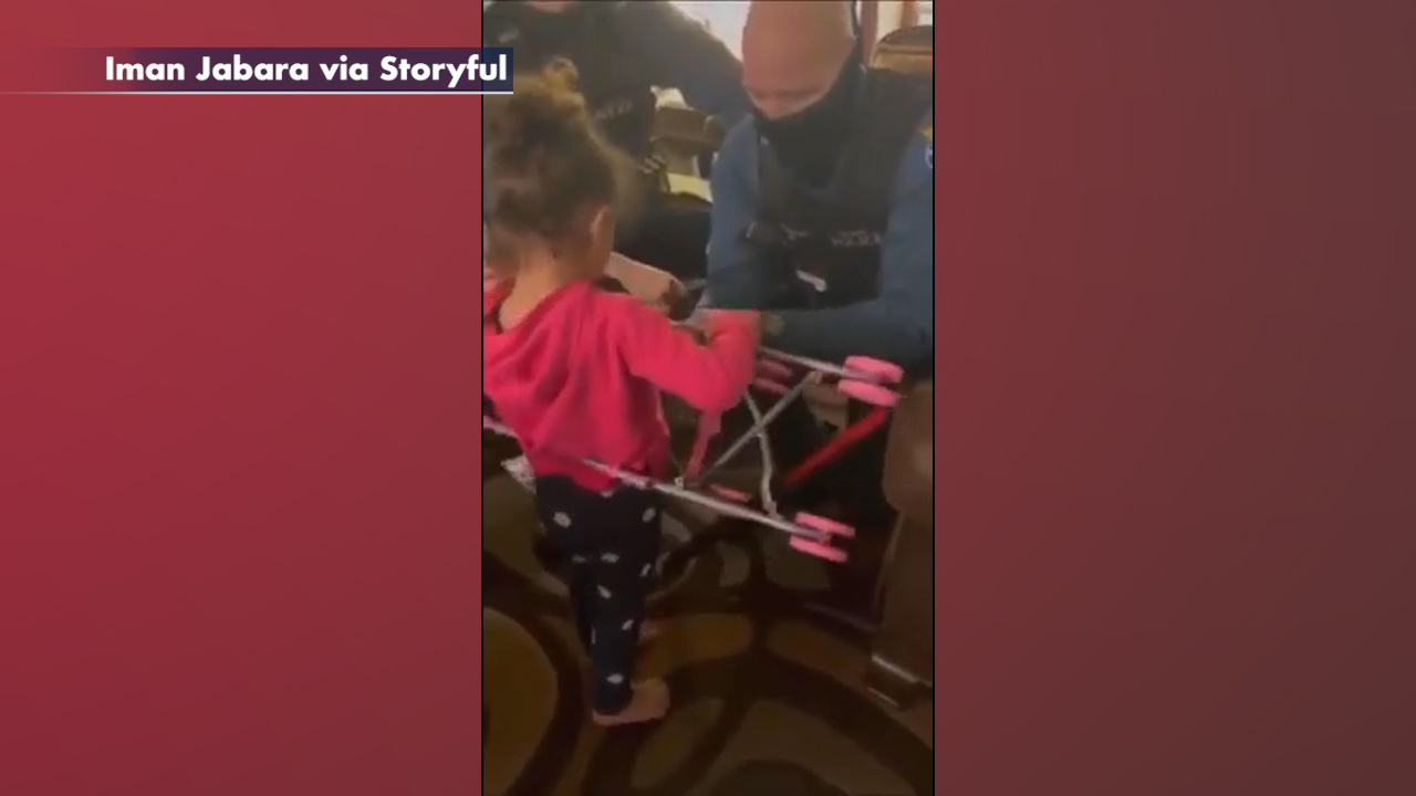 NJ police officers rescue girl from doll stroller, buy her a new one