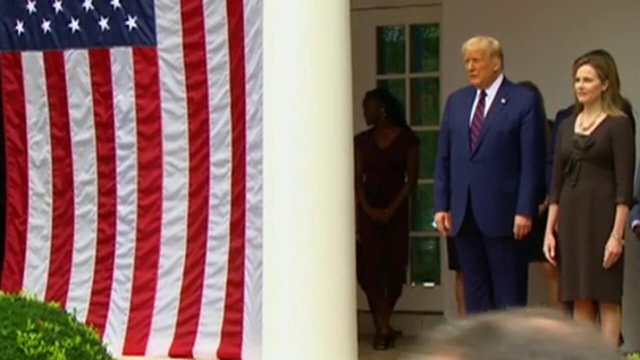 Confirmation battle looms as Trump picks Judge Barrett for Supreme Court
