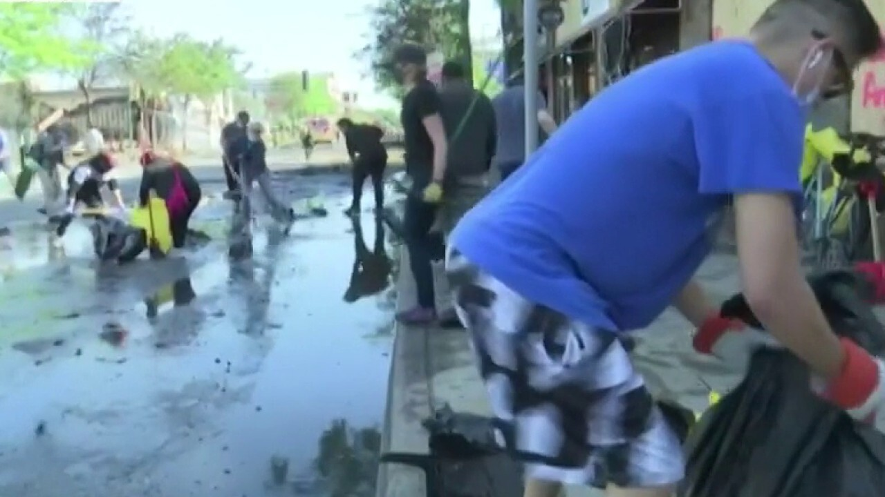 Volunteers help Minneapolis business owners clean up following riots