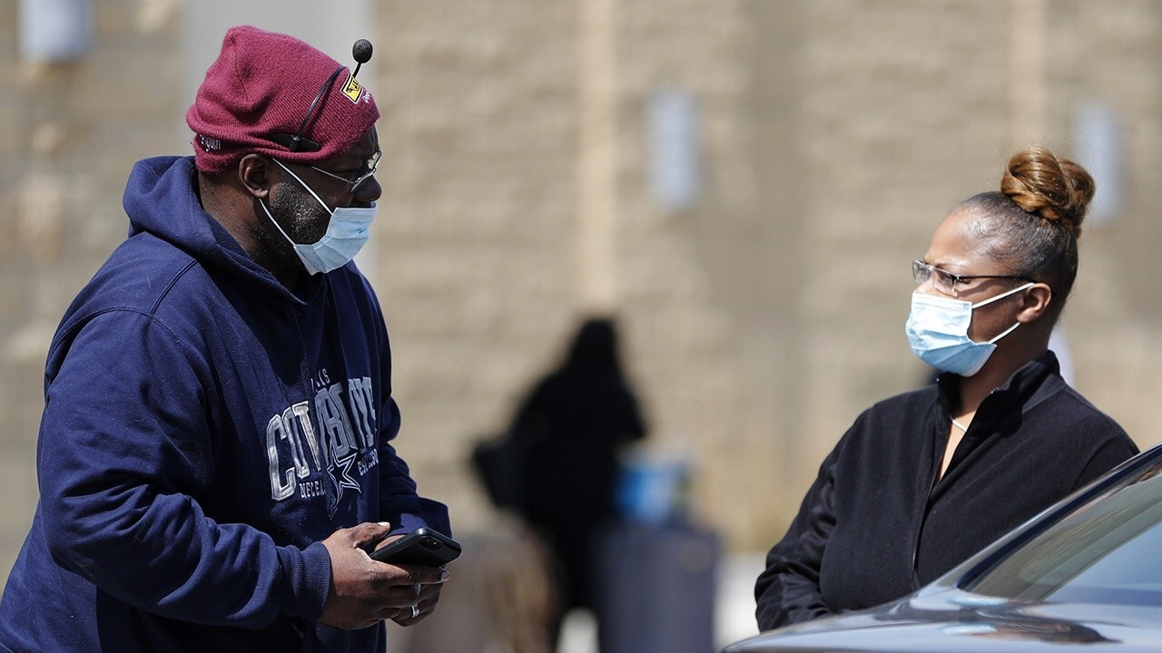 US braces for COVID-19 surge as pandemic measures show signs of working