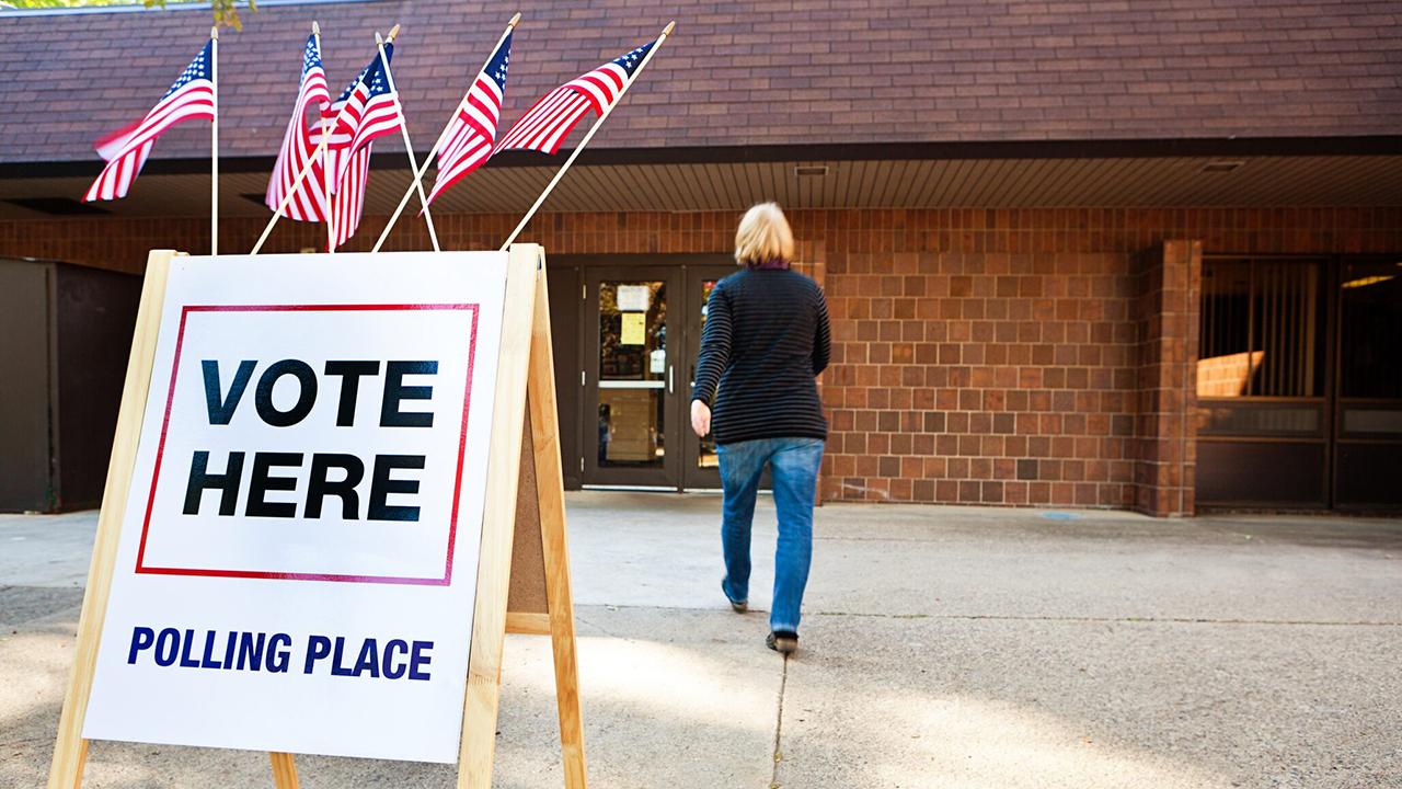 Democrats promote in-person voting
