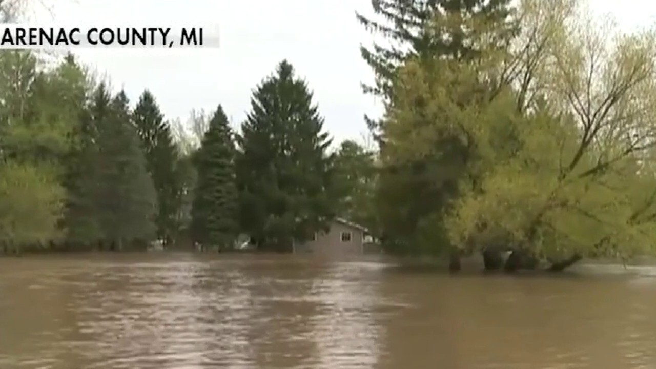 Thousands evacuated after two dams collapse in Michigan