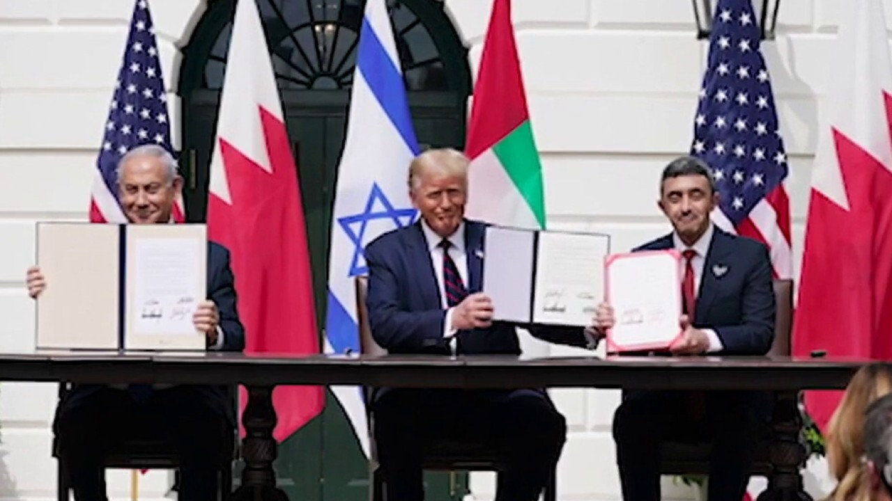 Trump declares 'dawn of a new Middle East' as he presides over signing of historic deals