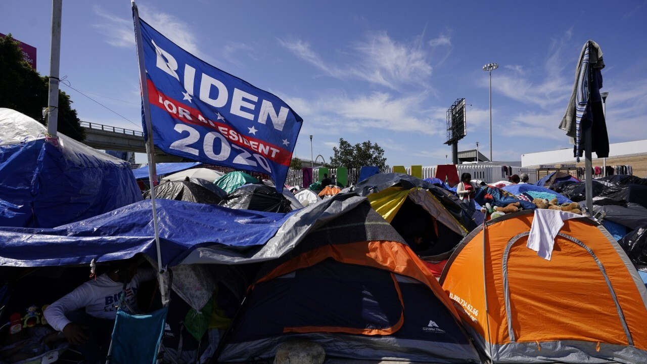 Migrant tent camp flies 'Biden for President' flag