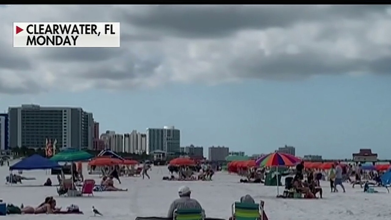 Florida governor under pressure to shut down state's beaches