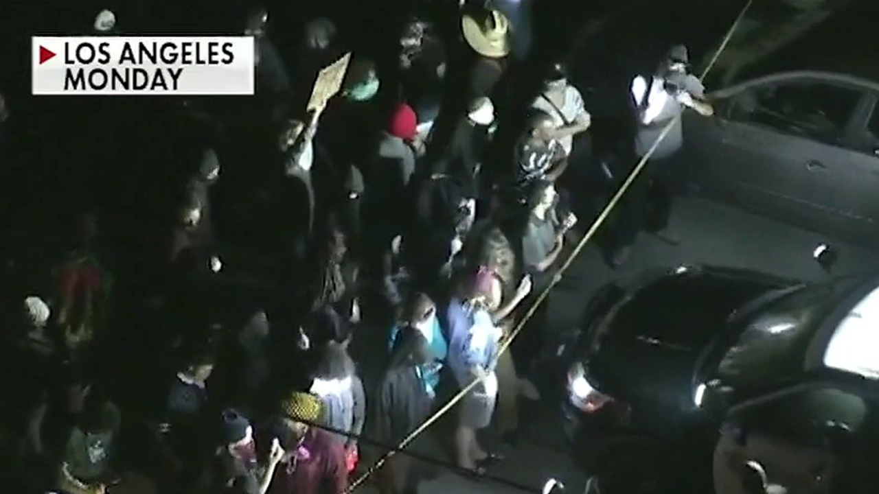 Massive crowds protest California police shooting