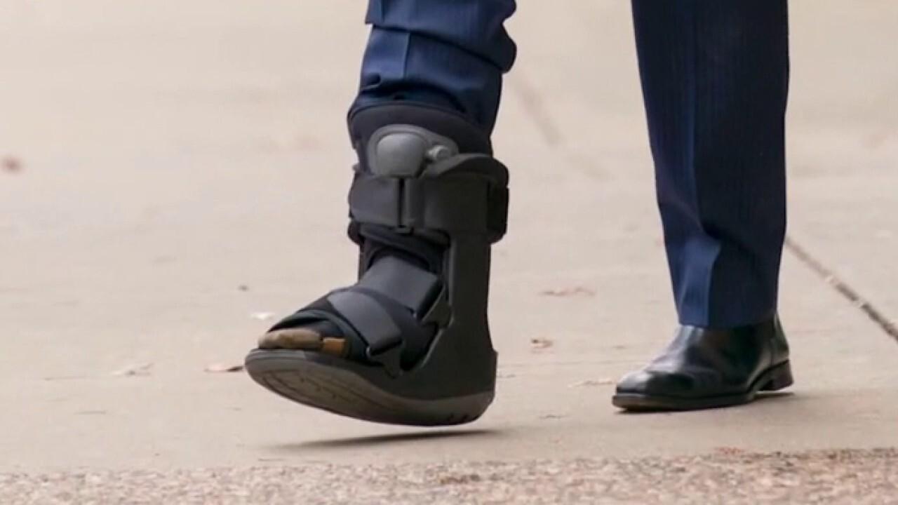 Joe Biden says foot injury happened while chasing dog's tail