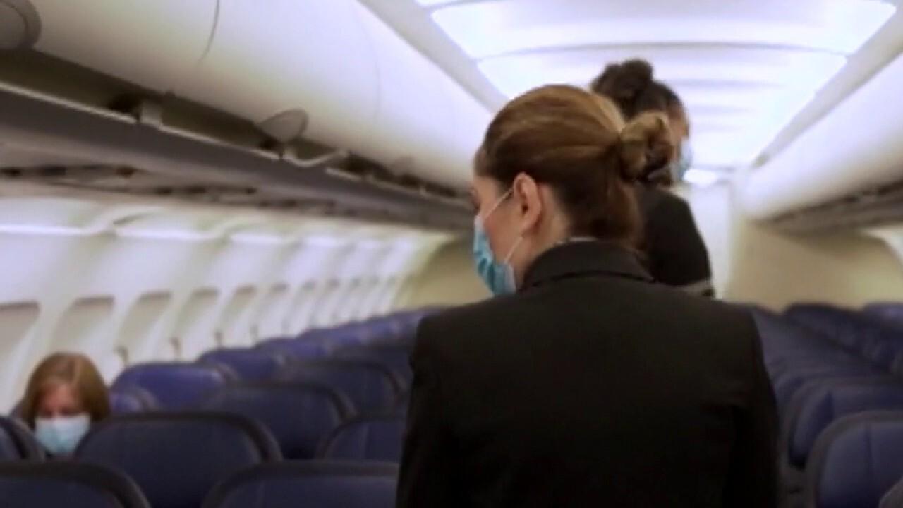 """国防部, 联合航空表示,蒙面乘客""""极不可能""""赶上COVID-19"""