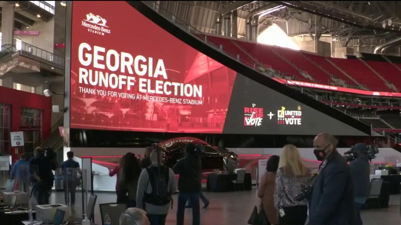 Millions vote early in Georgia Senate runoffs