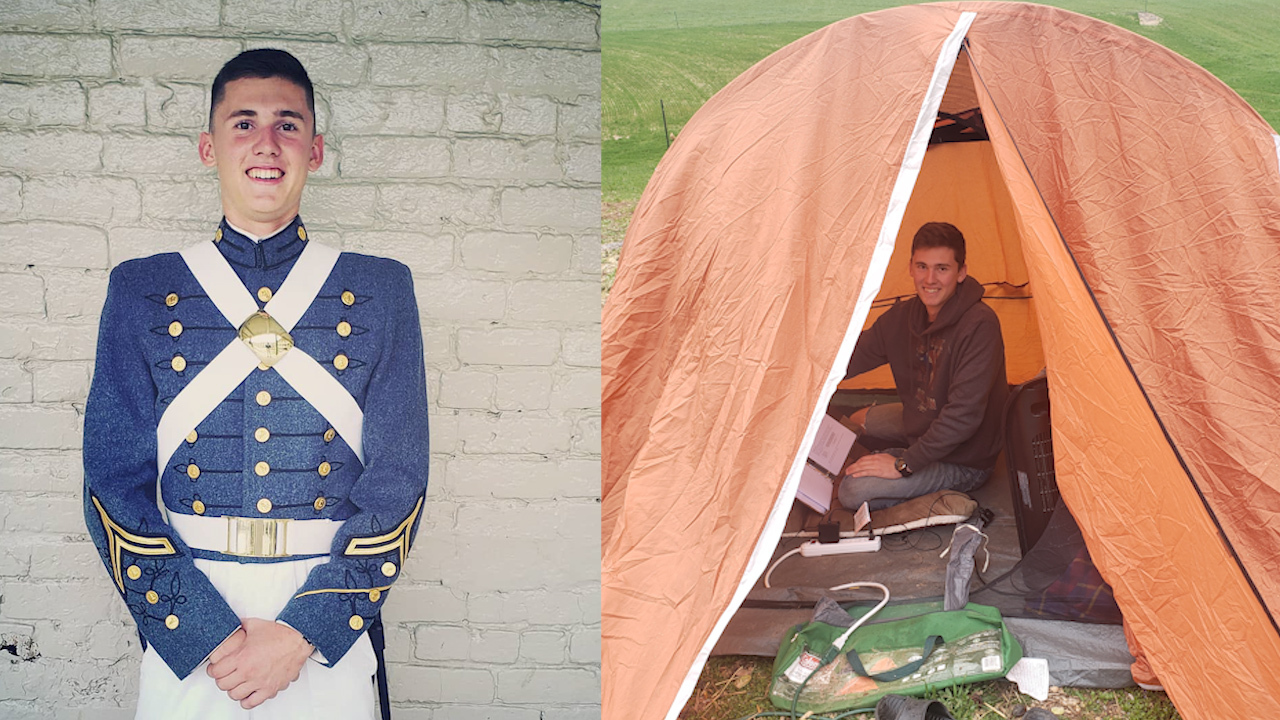 Military cadet finishes college schoolwork inside a tent