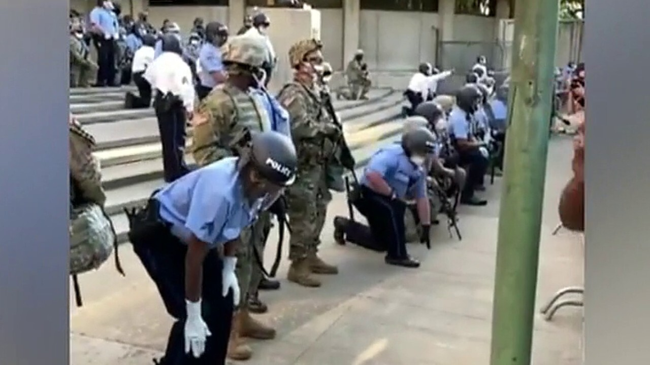Police take a knee with protesters in Philadelphia, go on offense in Los Angeles