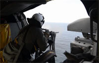 Sailors Conduct a Live-Fire Exercise From an SH-60 Helicopter